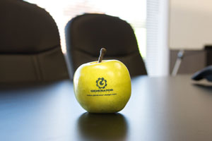 Plastic apple with Generator logo