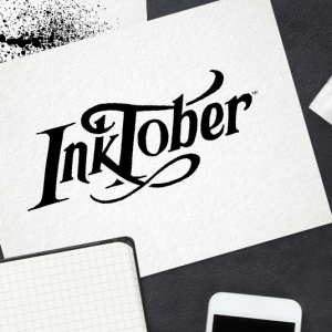 Inktober header, desk view with paper and ink